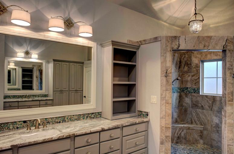 The master bathroom features customized gray paint color for raised panel cabinets.