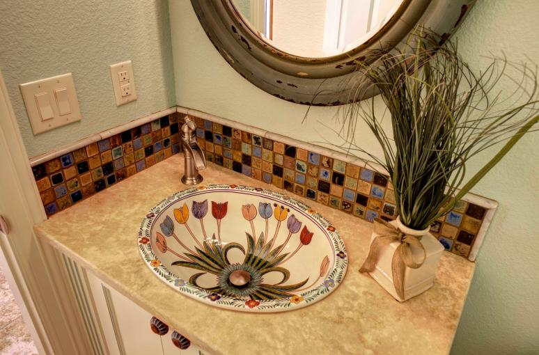 Custom painted and designed vanity with imported talavera sink.
